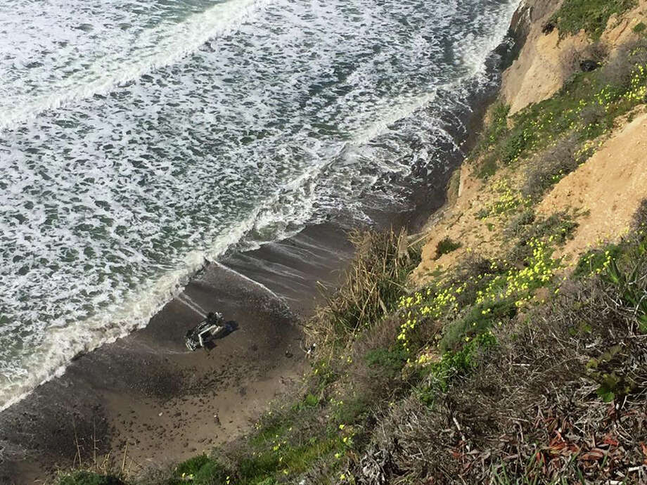 A car plunged about 300 feet off a cliff in Santa Cruz County on Monday morning with a female driver inside. Photo: California Highway Patrol / California Highway Patrol