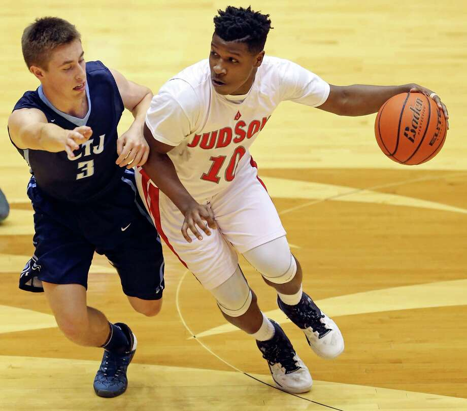 Judson's Devin Blair looks for room around Johnson's Tyler Payne during first half action of their Class 6A bi-district boys basketball playoff game held Monday Feb. 22, 2016 at the UTSA Convocation Center. Photo: Edward A. Ornelas, Staff / San Antonio Express-News / © 2016 San Antonio Express-News