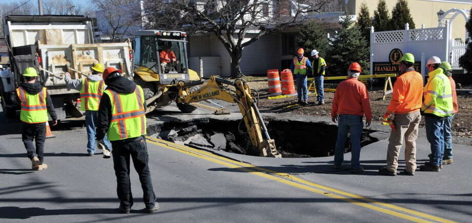 Repairs continue on the sinkhole on Campbell Avenue, Monday, Feb. 22, 2016, Troy, N.Y. (Brittany Gregory/Special to the Times Union) Photo: Brittany Gregory