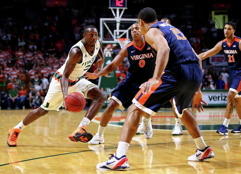MIAMI, FL - FEBRUARY 22: Davon Reed #5 of the Miami Hurricanes is defended by Malcolm Brogdon #15 of the Virginia Cavaliers during the game at the BankUnited Center on February 22, 2016 in Miami, Florida.  (Photo by Rob Foldy/Getty Images) ORG XMIT: 587708773 Photo: Rob Foldy / 2016 Getty Images