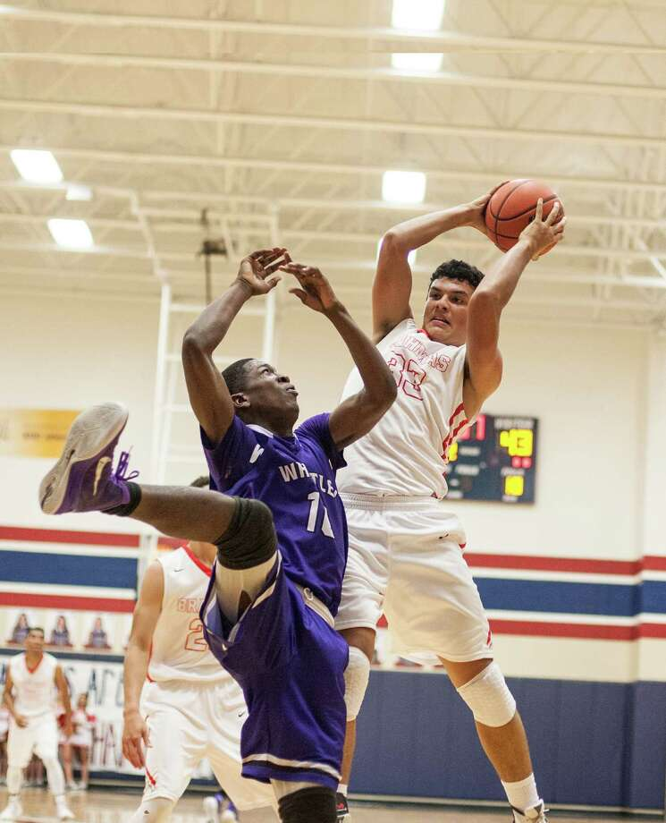 Tristen Williamson of Bellville grabs a rebound during a game Monday February 22, 2016. Wheatley played Bellville in a boys basketball playoff game at Tompkins High School in Katy, Texas. Photo: Michael Starghill, Jr. / © 2016 Michael Starghill, Jr.