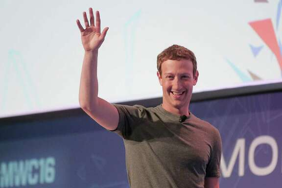 Facebook CEO Mark Zuckerberg waves to the audience as he arrives for a speech at the Mobile World Congress wireless show in Barcelona, Spain, Monday, Feb. 22, 2016. (AP Photo/Manu Fernandez)