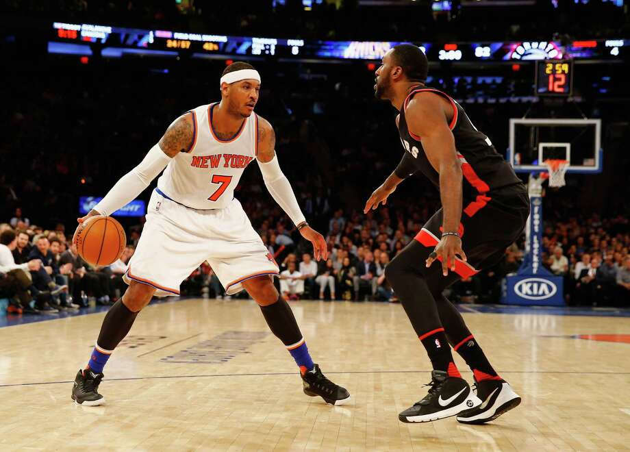 NEW YORK, NY - FEBRUARY 22:  Carmelo Anthony #7 of the New York Knicks dribbles against Patrick Patterson #54 of the Toronto Raptors during their game at Madison Square Garden on February 22, 2016 in New York City.  NOTE TO USER: User expressly acknowledges and agrees that, by downloading and/or using this Photograph, user is consenting to the terms and conditions of the Getty Images License Agreement.  (Photo by Al Bello/Getty Images) ORG XMIT: 575731177 Photo: Al Bello / 2016 Getty Images