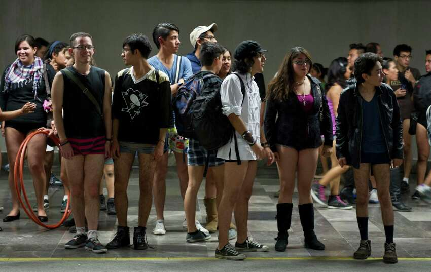 People wait for the train at a subway station during the worldwide 'No Pants Subway Ride' event in Mexico City on January 13, 2013. The 'No Pants Subway Ride', though in its 12th year, still surprises fellow passengers on public transit, and is spreading to other cities across the globe. AFP PHOTO/RONALDO SCHEMIDT