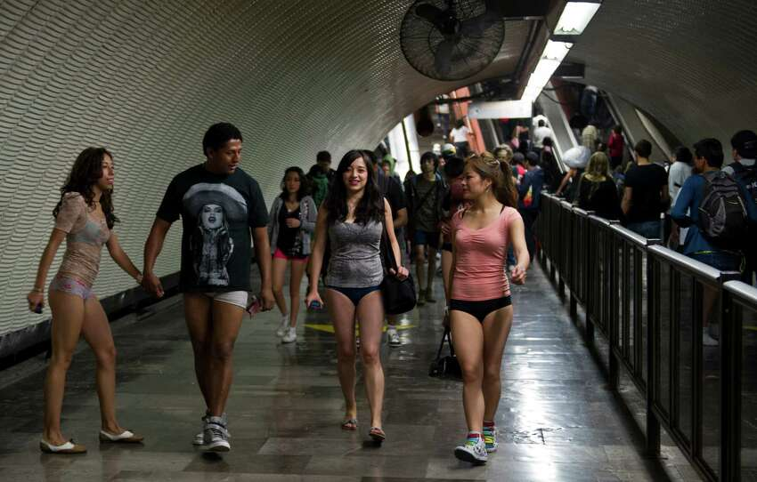 People walk through a subway station during the worldwide 'No Pants Subway Ride' event in Mexico City on January 13, 2013. The 'No Pants Subway Ride', though in its 12th year, still surprises fellow passengers on public transit, and is spreading to other cities across the globe. AFP PHOTO/RONALDO SCHEMIDT