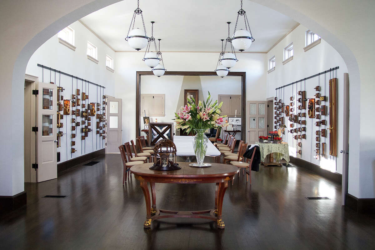 The great room and main dining room inside Leland Stone's home. Stone renovated and converted the old Roosevelt Library into a home and a multiuse space that houses the showroom for his fixture company, Stone Standard.