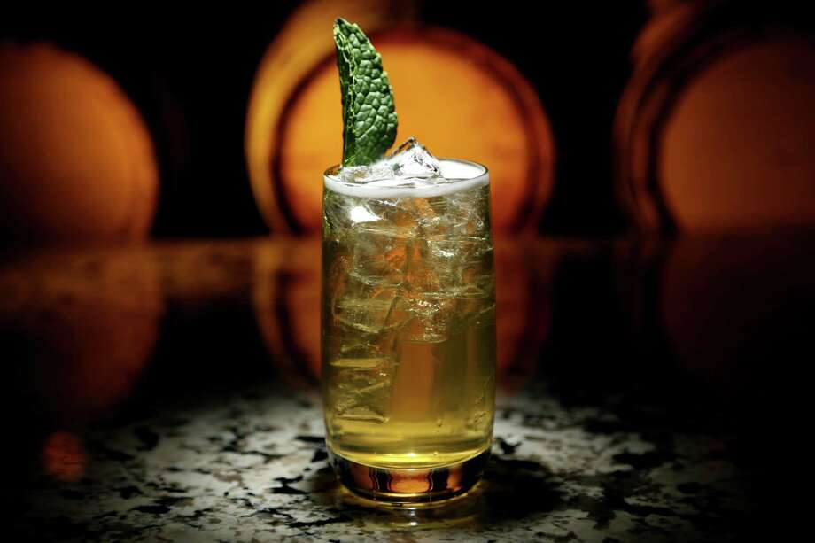 """""""Industry Incider"""" cocktail prepared by Joe Hausner, bar manager, at Pour Society Photo: Gary Coronado, Staff / © 2015 Houston Chronicle"""