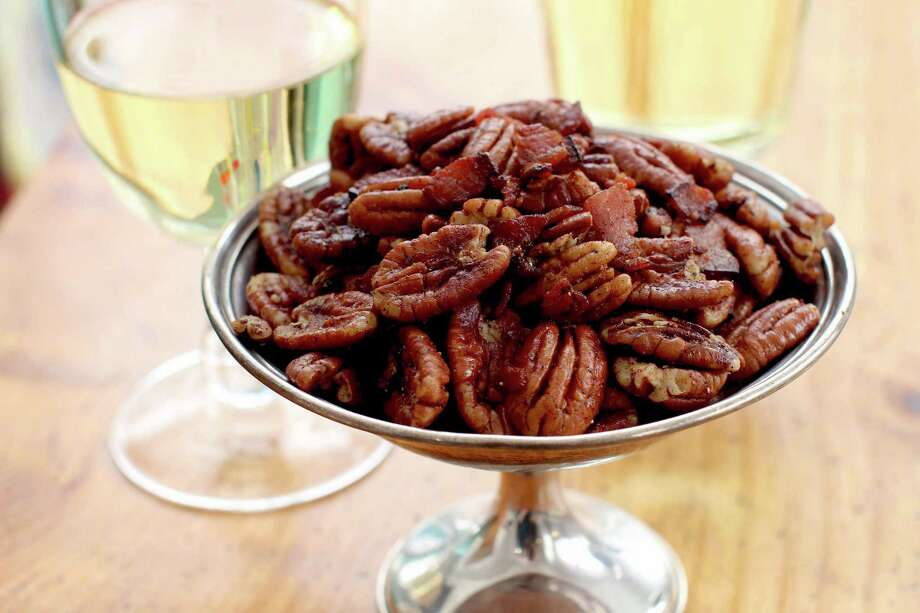 If you're looking for a surefire Oscar winner, serve spiced bacon pecans at your award-show gathering. Photo: Matthew Mead, FRE / 170582 AP