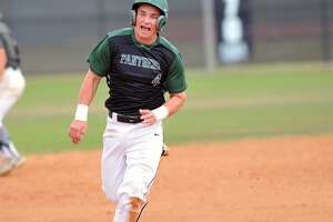Kingwood Park baseball team played a scrimmage game against Bryan Rudder, 2-20-16.  Kingwood Park won the game, 4-2.    Kingwood Park's Blake Ledoux (4) rounds second base after a hit to the outfield.