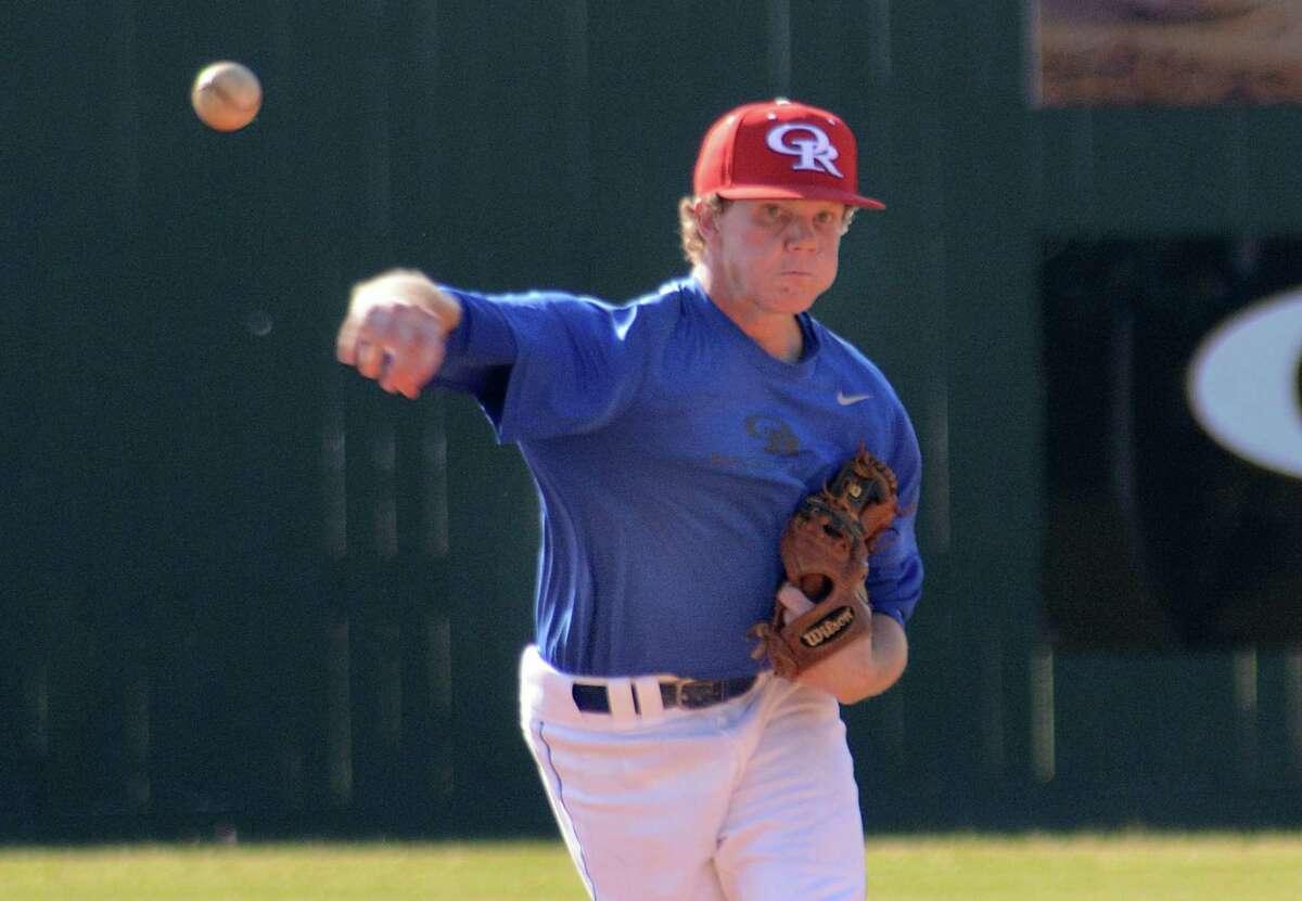 Oak Ridge shortstop Michael Lawson throws to first during the Brenham at Oak Ridge baseball scrimmage.