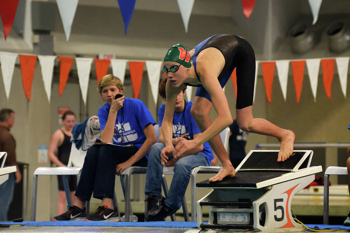 The Woodlands freshman Zoe Gawronska leaves the blocks in the Class 6A championship final of the girls 500-yard freestyle, a race in which she finished third, at the 2016 UIL State Swimming and Diving Championships at the Texas Swim Center in Austin.