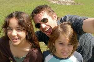 Samantha (Lorelei Linklater), Mason Sr. (Ethan Hawke), and Mason (Ellar Coltrane), age 9, in Richard Linklater s BOYHOOD.  Courtesy of Matt Lankes.  An IFC Films Release.