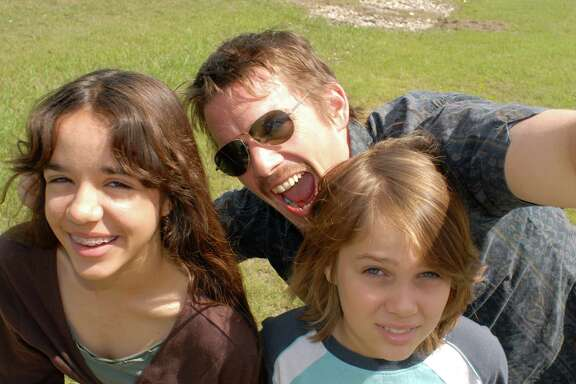 Samantha (Lorelei Linklater), Mason Sr. (Ethan Hawke), and Mason (Ellar Coltrane), age 9, in Richard Linklater s BOYHOOD.  Courtesy of Matt Lankes.  An IFC Films Release.