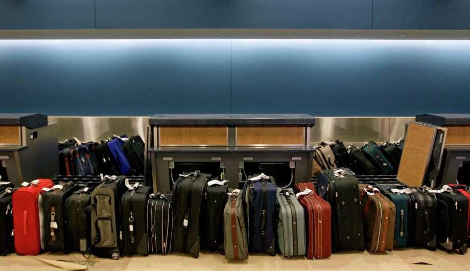 Luggage waits to be run through the baggage system for testing in the Maynard Holbrook Jackson Jr. International Terminal at Atlanta's airport. Photo: David Goldman /Associated Press / AP