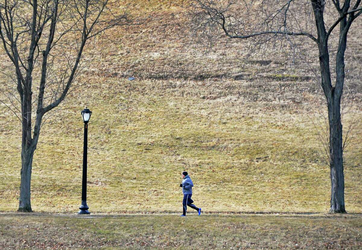 Chris Durant of Albany runs laps around Lincoln Park Tuesday Feb. 23, 2016 in Albany, NY. (John Carl D'Annibale / Times Union)