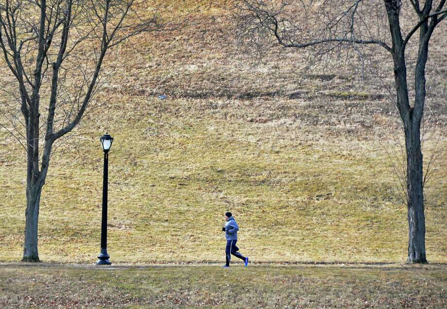 Chris Durant of Albany runs laps around Lincoln Park Tuesday Feb. 23, 2016 in Albany, NY.  (John Carl D'Annibale / Times Union) Photo: John Carl D'Annibale / 10035549A