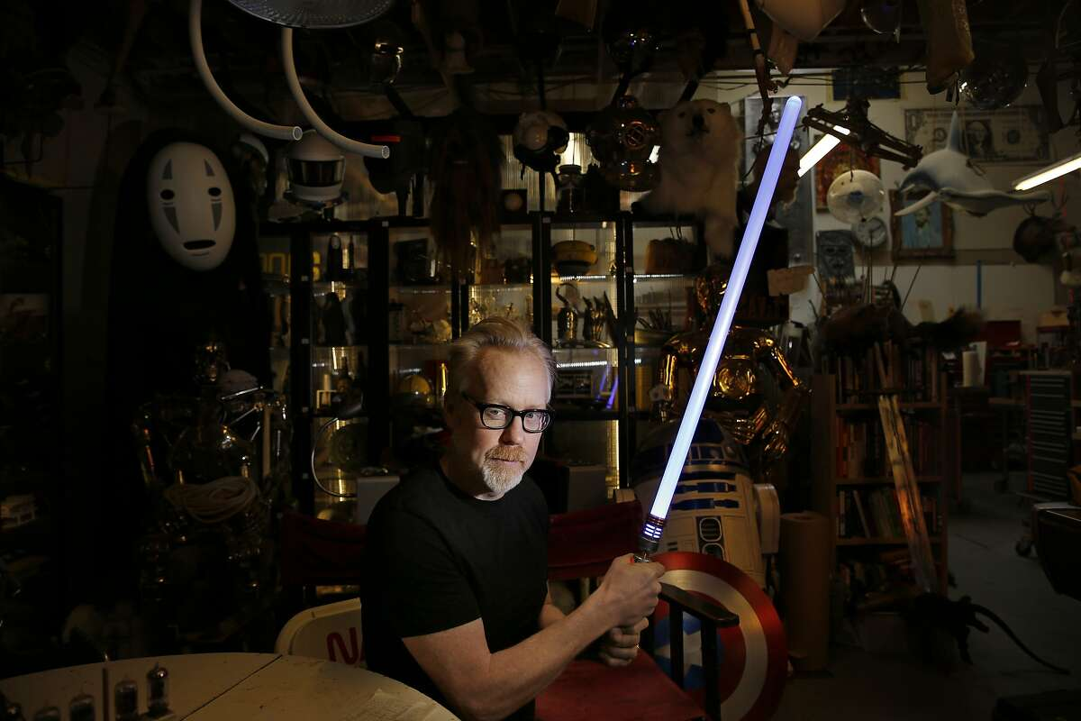 """Adam Savage of """"MythBusters"""" poses for a portrait with a light saber at his workshop in San Francisco."""