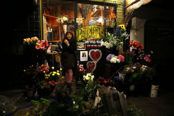Patricia Lanao waits for customers at her flower shop on Columbus Avenue in the North Beach neighborhood of San Francisco, Calif., on Monday, February 22, 2016.