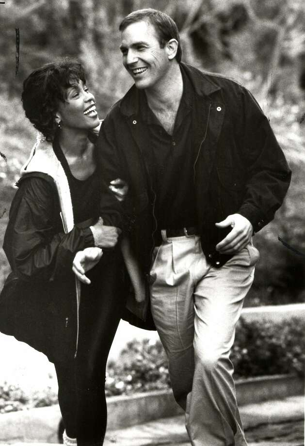 "Whitney Houston stars as a pop singer getting threatening notes from a stalker, with Kevin Costner in the title role of ""The Bodyguard."" Photo: Handout"