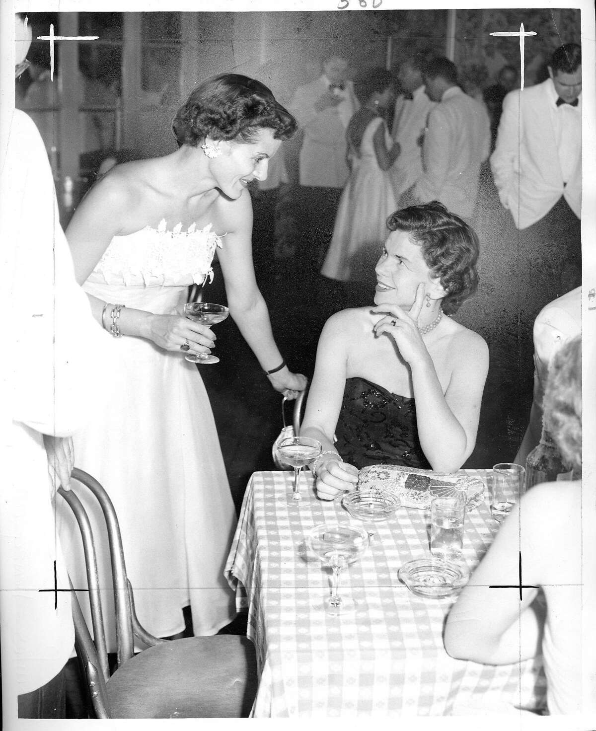 Constance Crowley Bowles, seated, with Beverly Nickel in 1954.