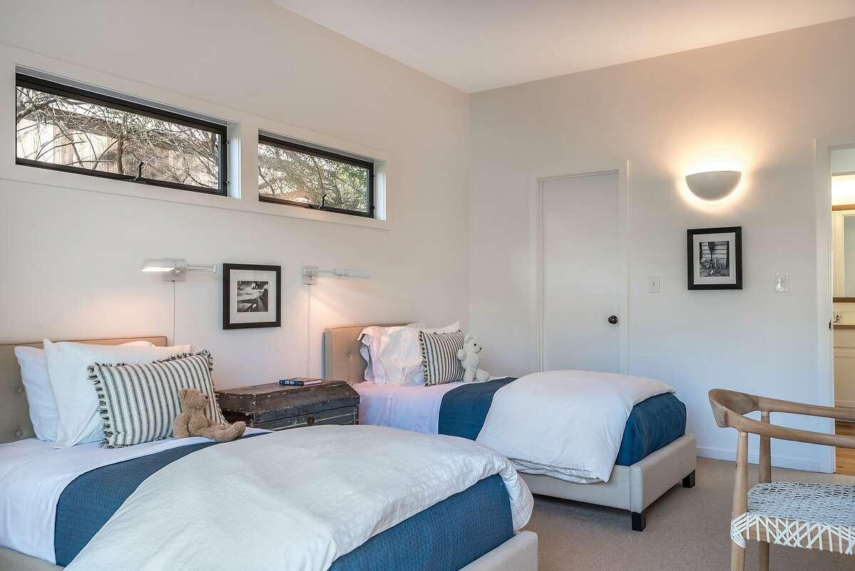 An en-suite bedroom accents this light-filled bedroom.