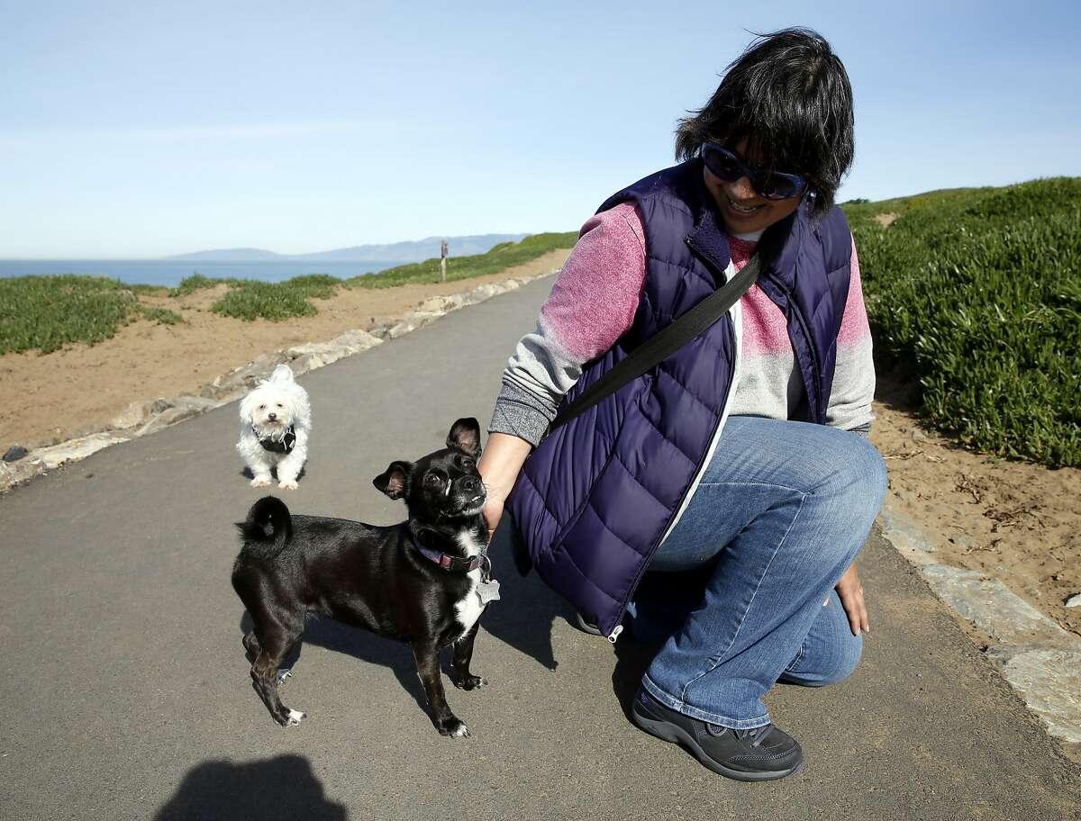 Christina Miller pets her dog Bobbi Lu at Fort Funston in San Francisco, California, on Tuesday, Feb. 23, 2016.