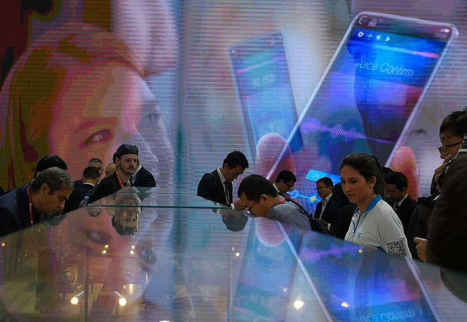 Smartphone models are on display at the Mobile World Congress wireless show in Barcelona, Spain. Photo: Lluis Gene, AFP / Getty Images