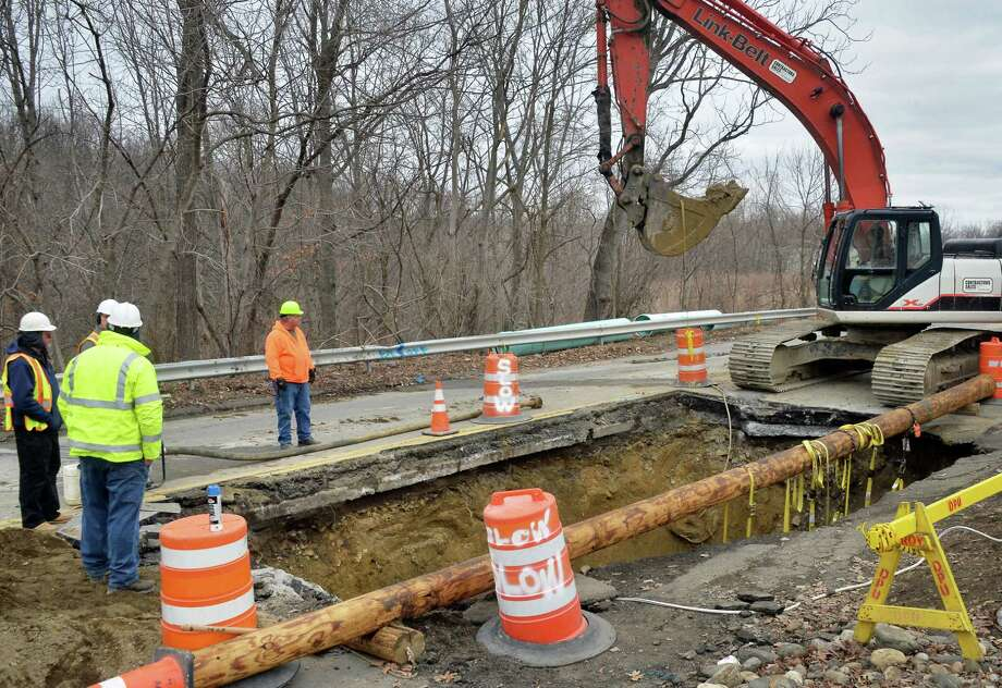 Crews continue to work to repair a sinkhole that started over the weekend on Campbell Avenue Tuesday, Feb. 23, 2016, in Troy, N.Y.  (John Carl D'Annibale / Times Union) Photo: John Carl D'Annibale / 10035550A