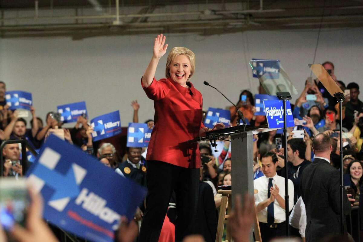 Hillary Clinton greets supporters during a campaign rally at Texas Southern University, Saturday Feb. 20, in Houston. ( Jon Shapley / Houston Chronicle )