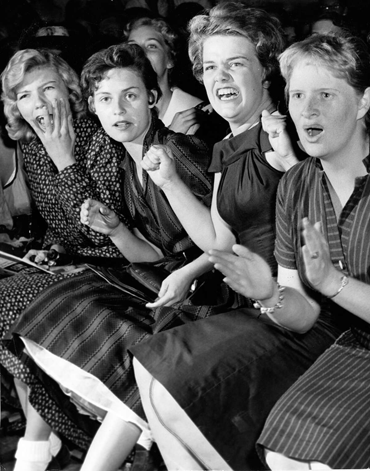 Fans watch Elvis Presley perform at the Sam Houston Coliseum in Houston.  October 13, 1956.