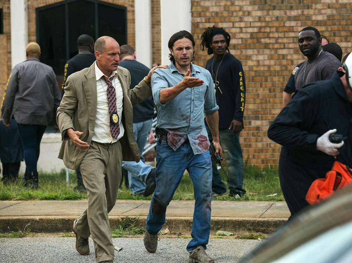 """This image released by Open Road Films shows Woody Harrelson, left, and Casey Affleck in a scene from """"Triple 9."""" (Bob Mahoney/Open Road Films via AP)"""