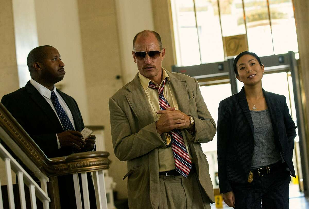 """This image released by Open Road Films shows Terence Rosemore, from left, Woody Harrelson and Michelle Ang in a scene from """"Triple 9."""" (Bob Mahoney/Open Road Films via AP)"""