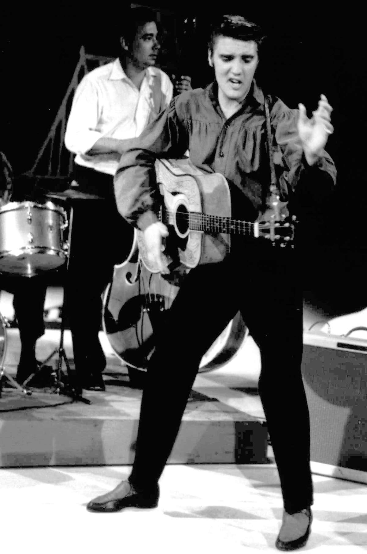 """FILE - In this Sept. 9, 1956 file photo originally released by the Museum of Television & Radio, Elvis Presley performs on the """"Ed Sullivan Show,"""" in New York. (AP Photo/Museum of Television & Radio, file)"""