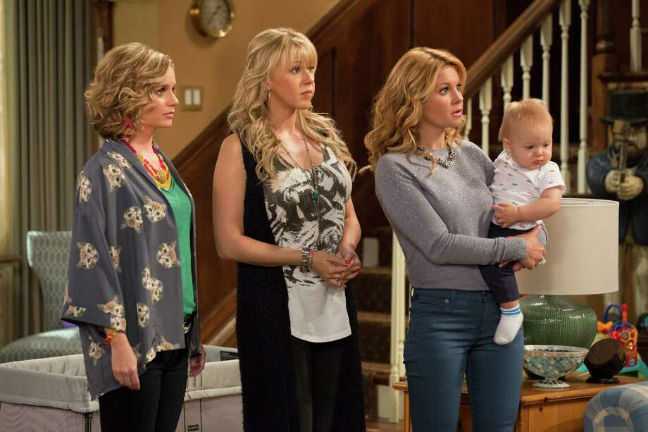 "This image released by Netflix shows, from left, Andrea Barber, Jodie Sweetin, and Candace Cameron Bure in a scene from, ""Fuller House,"" streaming on Netflix beginning on Friday, Feb. 26. (Michael Yarish/Netflix via AP)  ORG XMIT: NYET118 Photo: Michael Yarish / Netflix"