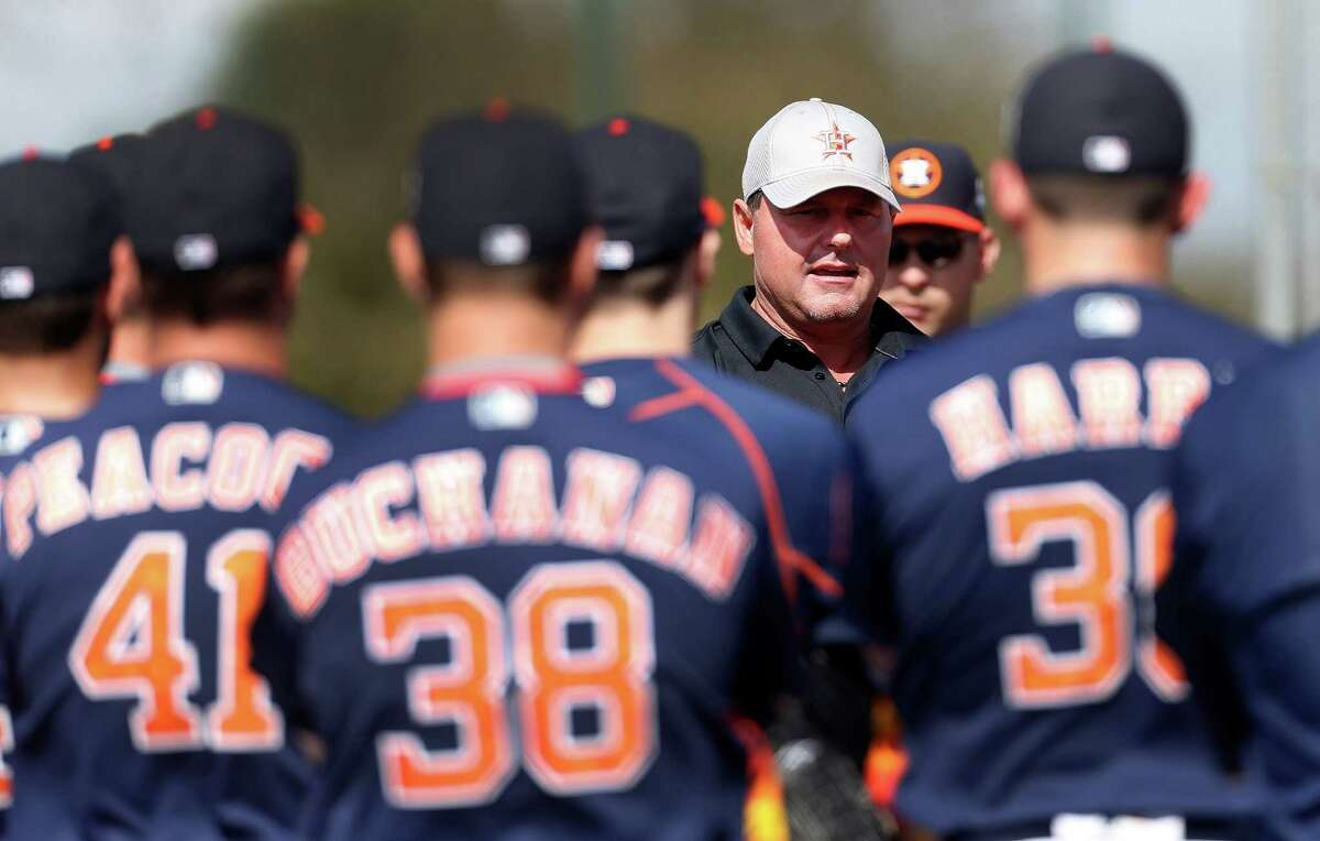 Former Houston Astros pitcher Roger Clemens talks with pitchers during the first full-squad workouts at the Astros spring training in Kissimmee, Florida, Tuesday, Feb. 23, 2016.( Karen Warren / Houston Chronicle )