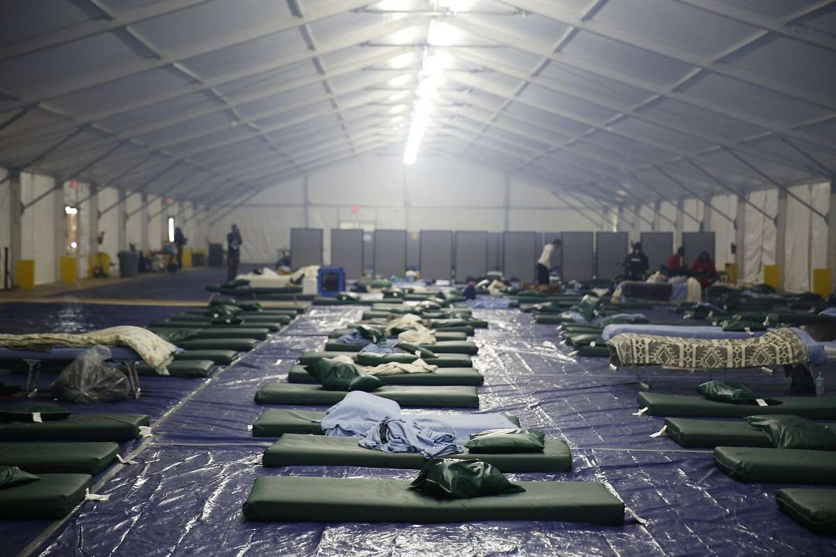 Sleeping mats are seen on the ground of a large tent at the shelter at Pier 80 on Tuesday, February 23, 2016 in San Francisco, California.