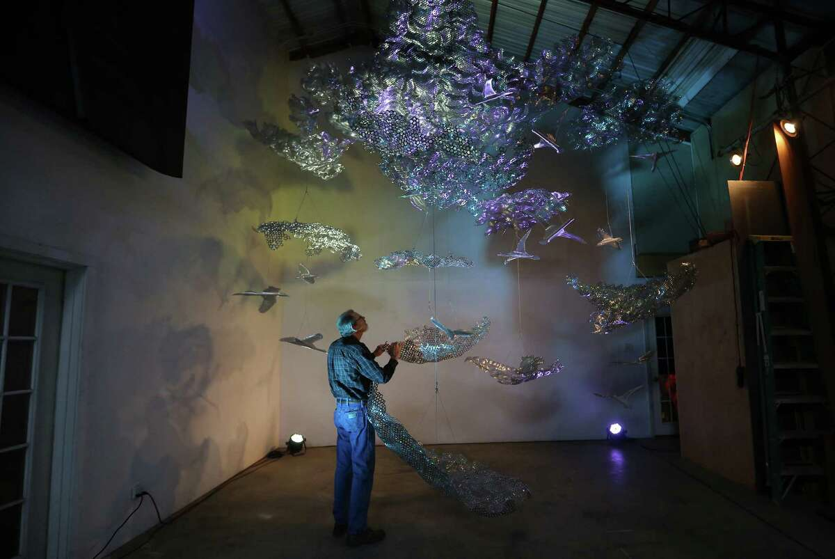 Ed Wilson's sculpture, in a scale model, is made with stainless steel elements to suggest birds and clouds.