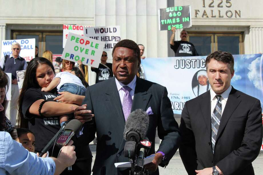 John Burris, center, speaks at a news conference to announce the filing of a federal lawsuit against Alameda County and Corizon Health Inc. Photo: Kimberly Veklerov / /