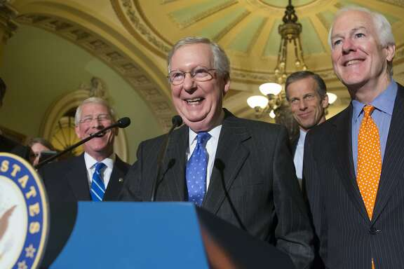 Senate Majority Leader Mitch McConnell, R-Ky., center, smiles as he is joined by, from right to left, Majority Whip John Cornyn, R-Texas, Sen. John Thune, R-S.D., and Sen. Roger Wicker, R-Miss., speaks with reporters following a closed-door policy meeting on Capitol Hill in Washington, Tuesday, Feb. 23, 2016. The Senate will take no action on anyone President Barack Obama nominates to fill the Supreme Court vacancy, Senator McConnell said as nearly all Republicans rallied behind his calls to leave the seat vacant for the next president to fill. His announcement came after Republicans on the Senate Judiciary Committee ruled out any hearing for an Obama pick. (AP Photo/J. Scott Applewhite)