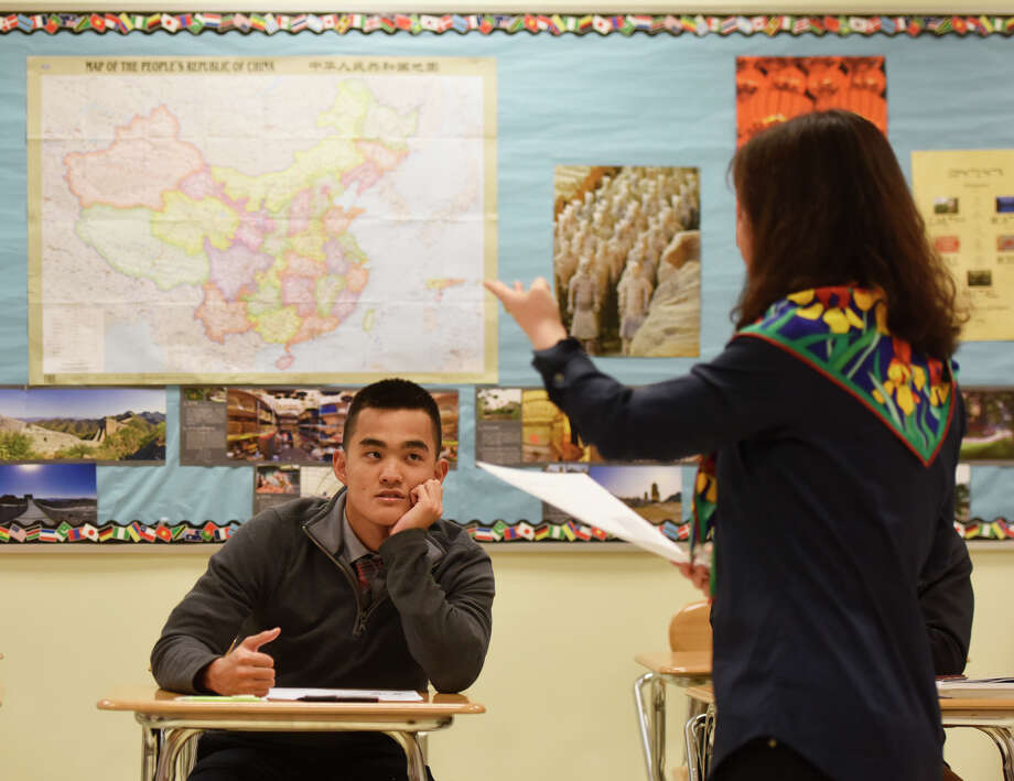 GHS senior Nicholas Handali listens to a lesson presented by Chinese language teacher Lin Young in the advanced placement Mandarin Chinese language class at Greenwich High School in Greenwich, Conn. Monday, Feb. 22, 2016. Photo: Tyler Sizemore / Hearst Connecticut Media / Greenwich Time