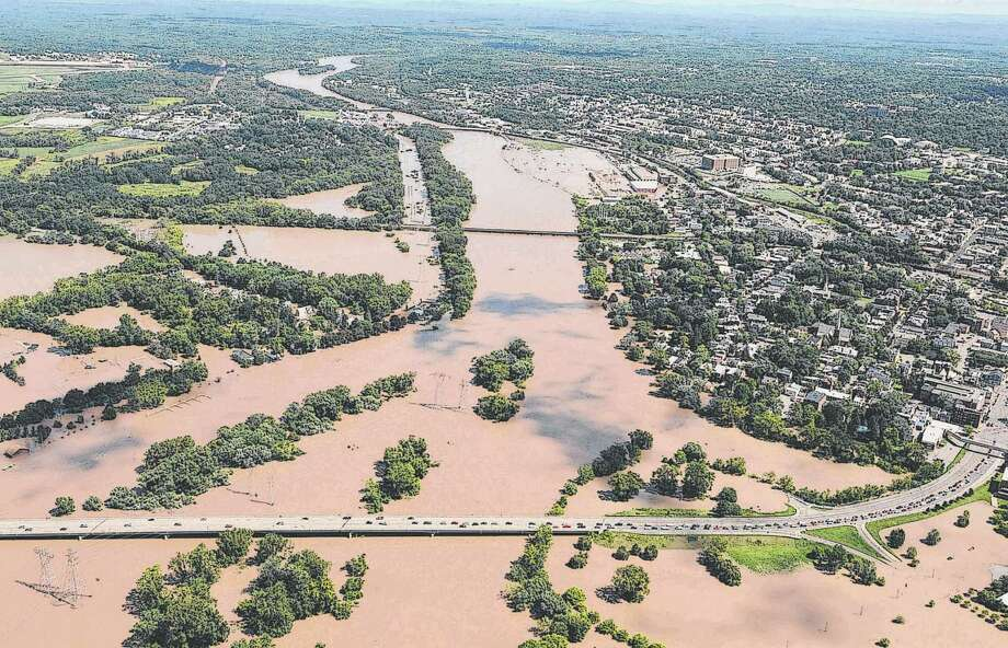 The Mohawk River overflows its banks in Scotia and Schenectady after Tropical Storm Irene in August 2011. (Will Waldron / Times Union) Photo: Will Waldron