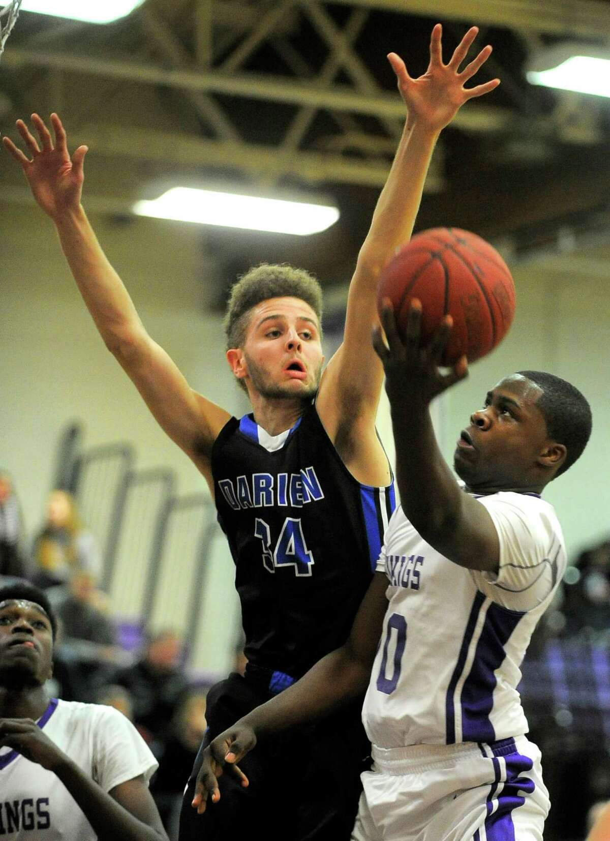 Westhill Tyrell Alexander puts up a shot underr pressure from Darien Alex Preston. Westhill defeated Darien 55-45 in a FCIAC league game at Westhill High School in Stamford on Feb. 12, 2016.