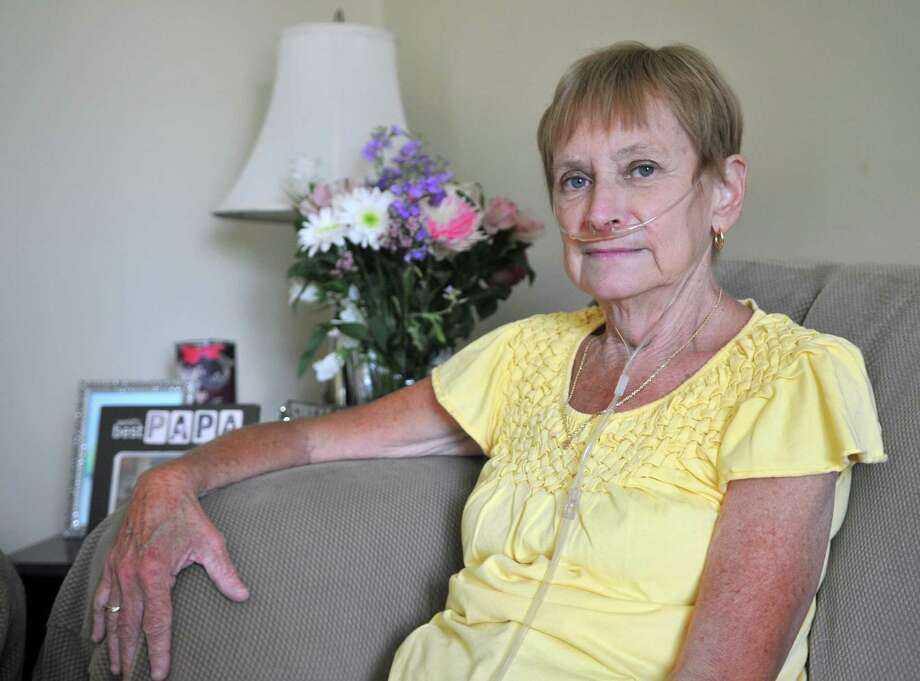 Carolyn Nichols poses for a photo inside her home on Friday, Aug. 7, 2015, in Guilderland, N.Y. Nichols needs a lung transplant and is moving to N.C. because she has gotten on a transplant list at Duke University Hospital. (Phoebe Sheehan/Special to The Times Union) Photo: PS / 00032937A