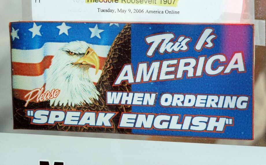 """In Philadelphia, a fast-food spot was subject to a discrimination claim for supporting """"English only"""". A sign read """"This Is America When Ordering Please Speak English"""" Philadelphia's Commission on Human Relations filed a discrimination complaint against Geno's over the signs, charging Geno's with denying service to someone because of his or her nationality in 2006. Photo: William Thomas Cain, Getty Images"""