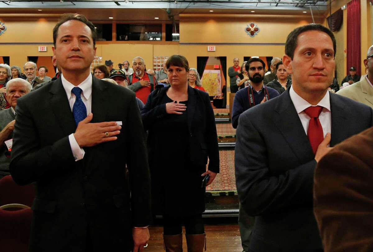 Before the debate between incumbent José Menéndez (left) and challenger Trey Martinez Fischer, candidates for Texas Senate District 26 took time to stand during pledge of allegiance with audience on Friday, January 29, 2016, at the Guadalupe Cultural Arts Center.