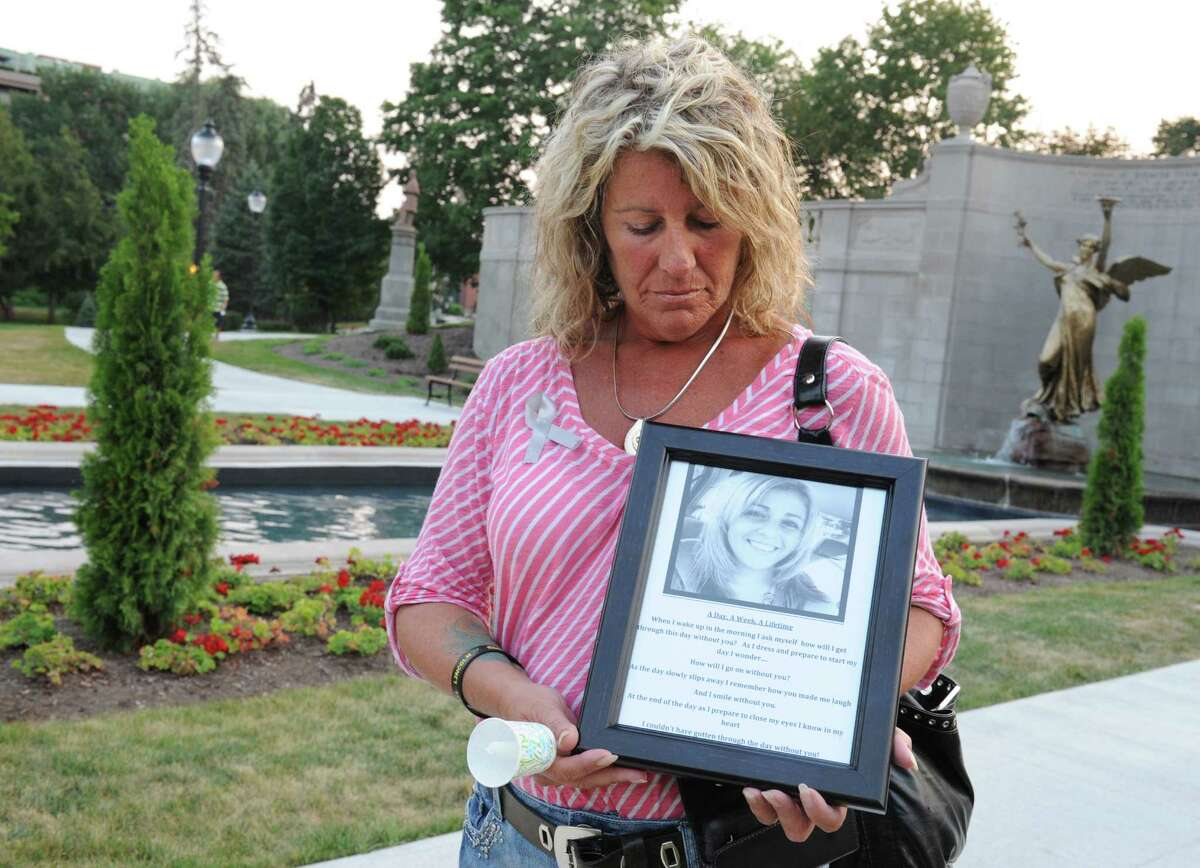 Patty Farrell of Colonie holds a photo of her daughter Laree Farrell-Lincoln, who died in 2013, on Monday, Aug. 31, 2015, during an overdose awareness candlelight vigil at the Spirit of Life Fountain in Congress Park in Saratoga Springs, N.Y. (Lori Van Buren / Times Union archive)