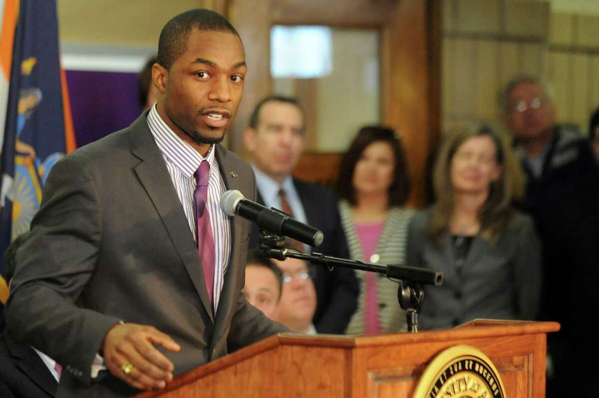 Jonathan Jones, Commissioner of City Dept. of Recreation, Youth and Workforce, left, speaks during a news conference on Tuesday, Feb. 23, 2016, at the Schuyler Building in Albany, N.Y. UAlbany plans to turn the former Albany High, what is known as the Schuyler Building, into the College of Engineering and Applied Sciences. (Cindy Schultz / Times Union)