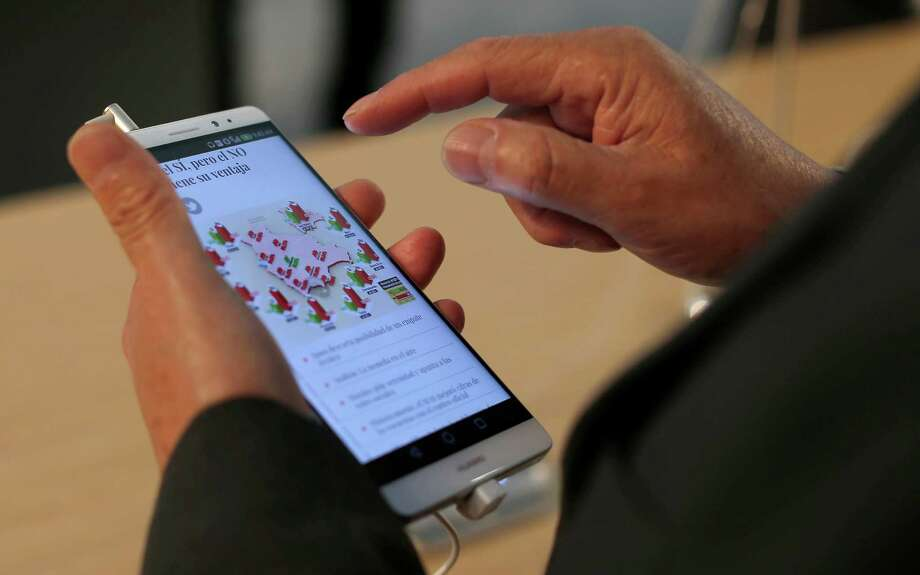 A Huawei Honor 5X is in use during the wireless show in Barcelona.  Photo: Manu Fernandez, STR / AP