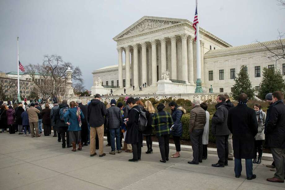 People stand in line to view the coffin of Supreme Court Justice Antonin Scalia outside the U.S. Supreme Court building last week. Readers continue to weigh in on whether a replacement nominated by President Barack Obama to succeed Scalia deserves a hearing in the Senate. Photo: Zach Gibson /New York Times / NYTNS