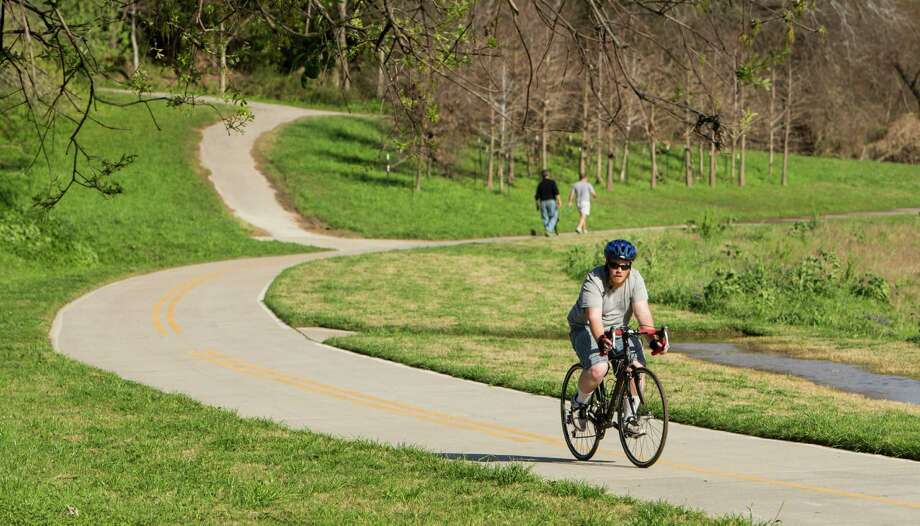 A cyclist uses a trail next to White Oak Bayou. Many of Houston's current bike trails are not connected. Photo: Brett Coomer, Staff / © 2016 Houston Chronicle